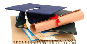 Cap-and-Diploma-on-Sprial-Notebook